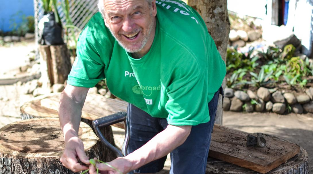 Retired volunteer helps build a vegetable garden in Fiji